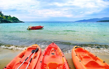 messinia: canoe at Stoupa beach in Peloponnese Greece - summer sports icon