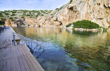 unexplored: Vouliagmeni lake Attica Greece, known for its constant temperature at 24 degrees Celsius all the year. Its underwater cave was never fully explored and a lot of divers had been lost in it Stock Photo