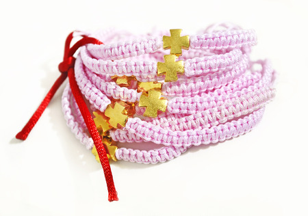 gold cross: pink macrame bracelets with gold cross and red ribbon