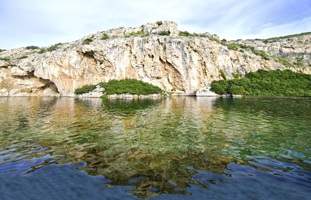 unexplored: Vouliagmeni lake Attica Greece, known for its constant temperature at 24 degrees Celsius all the year. Its underwater cave was never fully explored and a lot of divers had been lost in it.