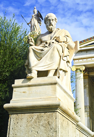 platon: the statue of Plato and goddess Athena outside of the Academy in Athens Greece Stock Photo