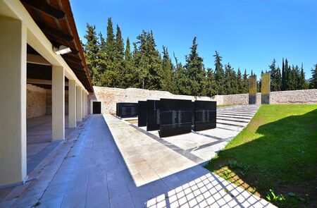 sightseeng: KAISARIANI GREECE, APRIL 4 2016: memorial at Kaisariani shooting range of 200 Greek communists, executed by the Nazi occupation authorities on 1st May 1944. Editorial use. Editorial