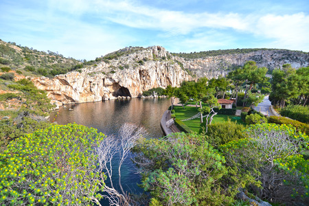 Vouliagmeni lake Greece, known for its constant temperature all the year. Its underwater cave was never fully explored and many divers had been lost in it. Stock Photo