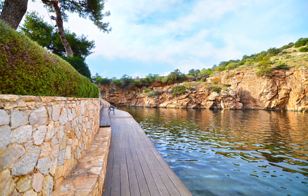 geophysical: Vouliagmeni lake Greece, known for its constant temperature all the year. Its underwater cave was never fully explored and many divers had been lost in it. Stock Photo