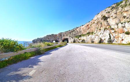 famous tunnel called holes of Karamanlis were built during his premiership and joins Varkiza with Athens