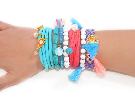 gypsy woman: womans hand wearing bohemian gypsy bracelets - advertise woman jewelry accessories