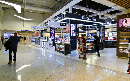 christmas perfume: ATHENS GREECE AIRPORT, DECEMBER 13 2015: duty free shops at Eleftherios Venizelos airport in Athens Greece, swarovski, lancome, dior shops, Editorial use. Editorial
