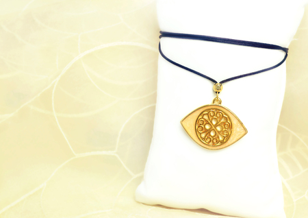 bijoux: still life jewelry - gold byzantine evil eye necklace Stock Photo