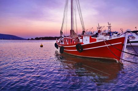 pink sunset: sunset boats at Eretria Euboea Greece - pink sunset background