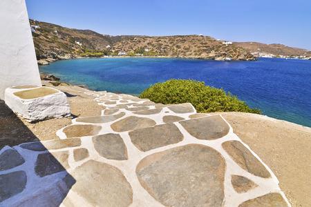 cycladic stair at Chrysopigi church and Apokofto beach Sifnos island Greece Stock Photo