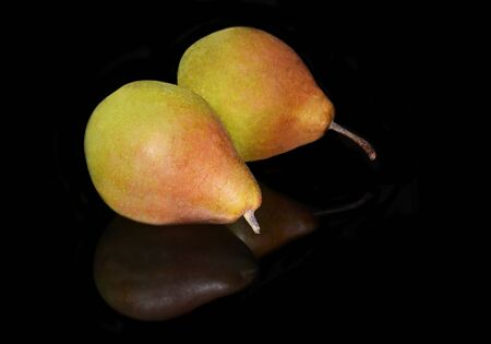 reflect: fresh pears reflect on black background - isolated fruits