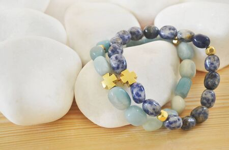 sodalite: Sodalite and Amazonite gemstone bracelets with cross - fashion jewelry advertisement