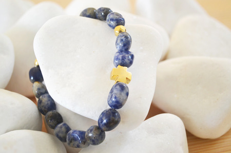 sodalite: Sodalite gemstone bracelet with gold cross - fashion jewelry advertisement