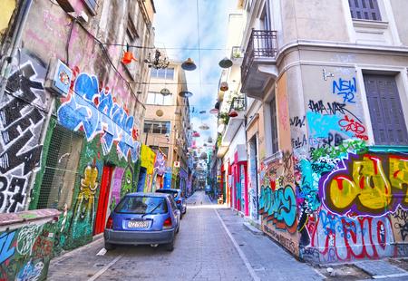 window graffiti: PSIRRI ATHENS GREECE, FEBRUARY 18 2017: road with colorful graffiti at Psirri neighborhood Monastiraki Athens Greece. Editorial use.
