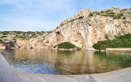 Vouliagmeni lake Greece - known for its constant temperature all the year - its underwater cave was never fully explored and many divers had been lost in it Stock Photo