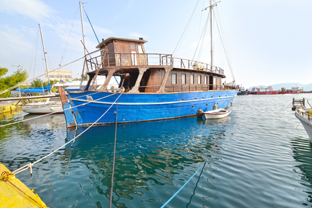 famous industries: old wooden boat at Eleusis port Greece