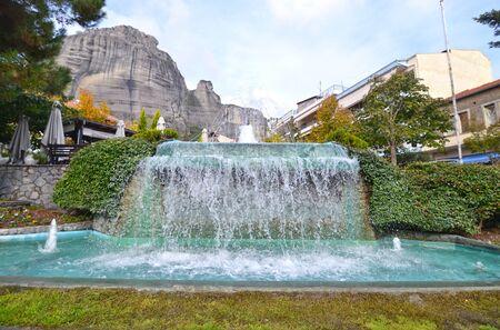 kalabaka: fountain at Kalambaka town and Meteora mountains background Greece