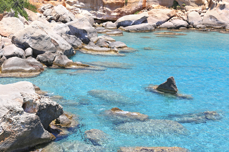 inaccessible: transparent turquoise sea at Petrified forest Lakonia Peloponnese Greece