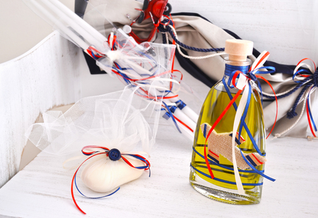 greek Orthodox christening objects - baptism oil, soap and candles Stock Photo
