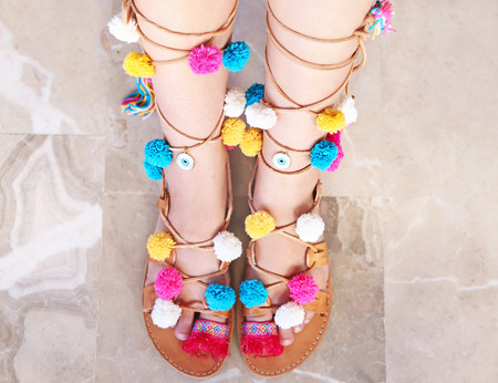 greek leather sandals with colorful pom pom and evil eye Stock Photo
