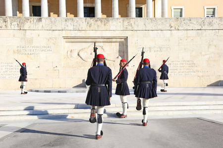ATHENS GREECE, DECEMBER 02 2017: greek evzones, greek tsolias, guarding the presidential mansion in front of the tomb of the unknown soldier, army infantry. Editorial use.