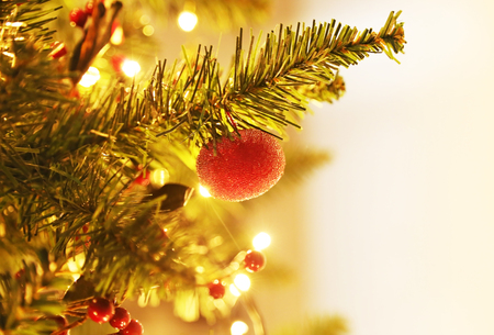 Christmas tree with decorative ornaments, balls and golden lights - bokeh lights background