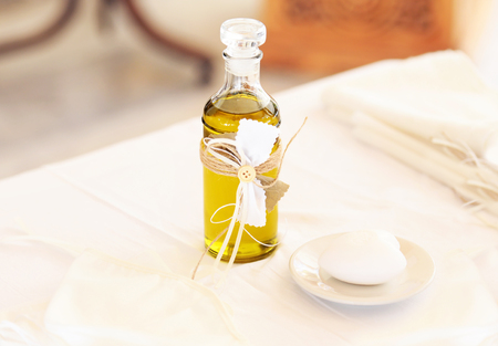 christening decoration with baptism oil, candles and soap - greek Orthodox christening