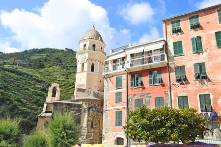 traditional buildings in Vernazza village and the Santa Margherita di Antiochia Church Italy Editorial