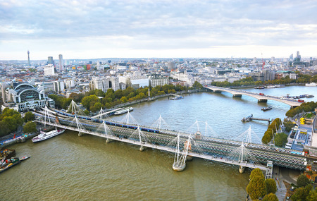 cityscape of London city - view of Thames river and Hungerford bridge - landscape from above