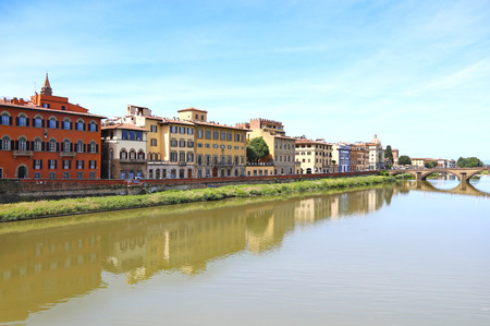 landscape of Florence or Firenze city Italy with impressive water reflections of the buildings on Arno river