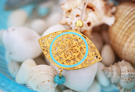 gold Byzantine necklace with turquoise semi precious stone - summer gemstone jewelry advertisement Stock Photo