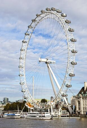 LONDON UNITED KINGDOM, OCTOBER 23 2018: the giant ferris wheel London Eye in front of the Thames river London United Kingdom. Editorial use.