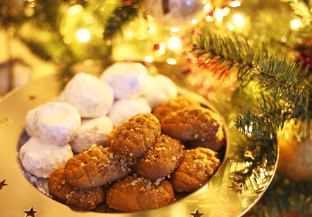 greek melomakarona and kourabies - traditional Christmas cookies with honey and nuts and sugar buns Archivio Fotografico