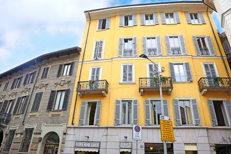 MILAN ITALY, MAY 31 2018: traditional architecture buildings at Milan city Italy - building with yellow wall. Editorial use.