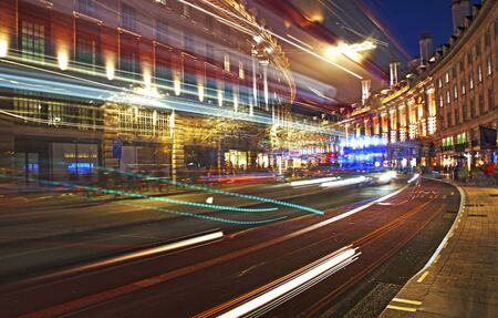 LONDON UNITED KINDOM, OCTOBER 25 2018: night scene of London city - long exposure photography with moving bus and cars. Editorial use. Editorial