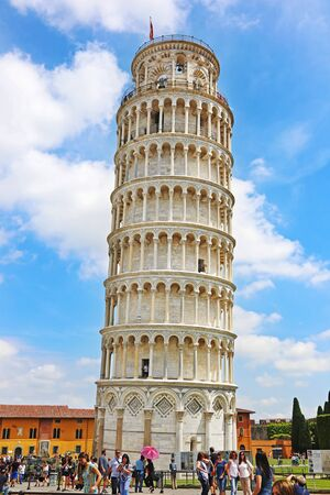 PISA ITALY, JUNE 02 2018: tourists posing in front of the leaning Pisa tower in Italy - one of the most famous italian landmarks. Editorial use.