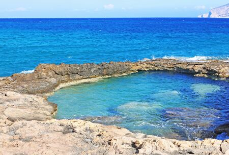 natural pool of the sea at Ano Koufonisi island Cyclades Greece Banco de Imagens