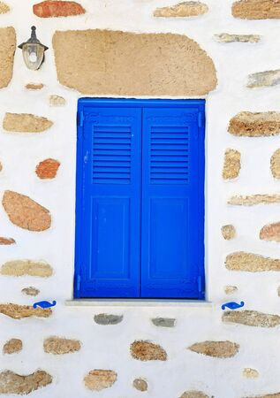 traditional blue window and stone wall at Ano Koufonisi island Cyclades Greece