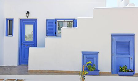 traditional architecture of Cyclades islands - Ano Koufonisi island Greece - purple doors and windows Banco de Imagens