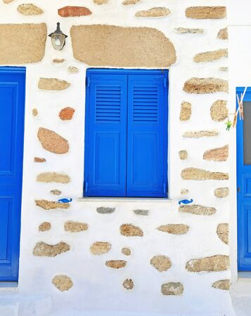traditional blue window and stone wall at Ano Koufonisi island Cyclades Greece - Koufonisia Greece