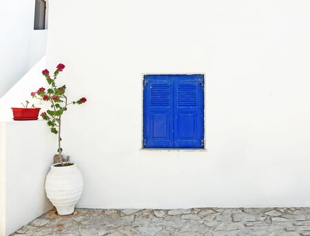 traditional architecture - blue wooden window and bougainvilleas at Ano Koufonisi Greece