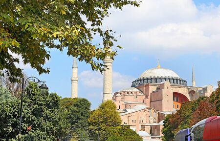 ISTANBUL TURKEY, SEPTEMBER 03 2019: part of Hagia Sophia behind the trees in Istanbul Turkey. Editorial use. Editorial