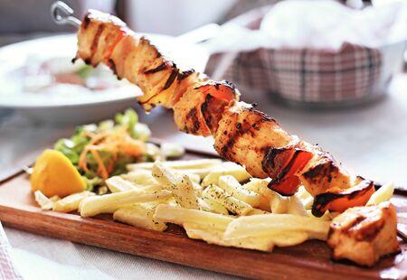 traditional greek souvlaki with chicken and potatoes - greek kontosouvli - greek cuisine