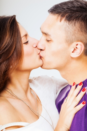 young couple kissing photo