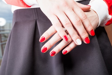 with people: modern manicure work shown on a womans hands