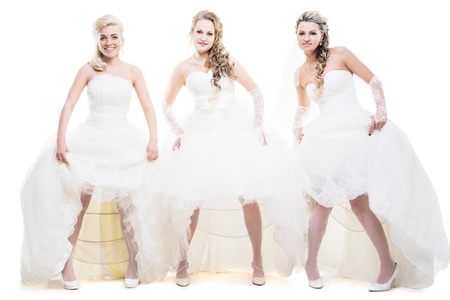hairstyling: three brides with hairstyling and makeup studio shot  isolated on white