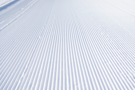 corrugation: Slanting line of snowcat on white snow