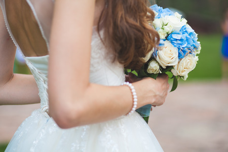 bride portrait with hairstyling and bouqet outdoors
