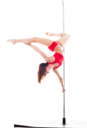 Mujer que hace la danza del poste, aislado en blanco