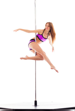 Woman doing pole dance, isolated on white